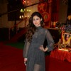 Mouni Roy poses for the media at the Annual Day of Children's Welfare Centre High School