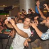 Varun Dhawan clicks a selfie with fans at the Promotions of Badlapur at R City Mall
