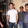 Varun Dhawan poses for the media at the Special Screening of Badlapur