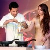 Chef Kunal Kapur prepares a dish for Soha Ali Khan at Magnum Promotional Event