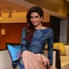 Karishma Tanna poses for the media at Sonam and Paras Modi's SVA Store Launch