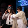 Amitabh Bachchan distributes helmets at the Road Safety Awareness Campaign by Thane Traffic Police