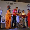 Anu Malik presents an award to a girl at IMC Ladies Wing Event