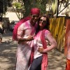 Deepshikha Nagpal and Kaishav Arora pose for the media at Shabana Azmi's Holi Bash