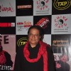 Anup Jalota poses for the media at a Musical Event