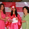 Lara Dutta giving scholarship to the winner at Fair & Lovely Foundation Event