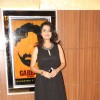 Amruta Subhash poses for the media at the Premier of Coffee Aani Barach Kahi