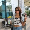 Jacqueline Fernandes poses for the media at Airport