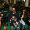 Riteish Deshmukh poses with Genelia and their Son Riaan at KL Airport