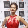 Esha Gupta poses for the media at Elle Beauty Awards