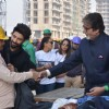 Big B Donates Clothes to workers at construction site!