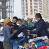 Big B Donates Clothes and interacts with workers!
