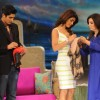 Priyanka Chopra and Vijendra Singh giving their autograph