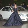 Ameesha Patel poses for the media at Mukesh and Nita Ambani's Bash