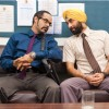 Ranbir Kapoor talking to a man | Rocket Singh: Salesman of the Year Photo Gallery