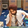 Ranbir Kapoor receiving a phone | Rocket Singh: Salesman of the Year Photo Gallery