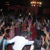 Star Pariwar artist playing Garba and Alisha Khan dancing in the center