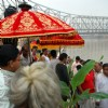 Popularly known as Lord Ganesh''s wife,Kalabou is being taken to the Ghat for bathing which is a popular ritual in Durga puja
