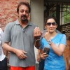 Sanjay & Manyata Dut tpose after casting his votes today for Maharashtra Elections