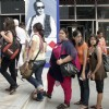 Girls stand in a queue to show the screening of a film on 15th Kolkta Film Festival at Nandan on Wednesday