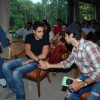 Bollywood actors Imran Khan and Dino Morea posing for photographers in Mumbai