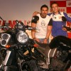 Motogp world champion Valentino Rossi and Bollywood actor John Abraham at a press meet in New Delhi on Sunday