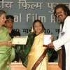 President Pratibha Devisingh Patil presenting best playback singer award to Hariharan at the ''''56 National Film Awards'''', in New Delhi on Friday