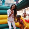 Pantaloons Femina Miss India 2010 finalists play with children during their visit to A K Munshi Yojana''s school for mentally challenged children, J T Sheth Mandbuddhi Vikas Kendra at C P Tank in Mumbai on Wednesday, 07 April 2010