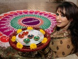 Bollywood actress Poonam Jhawer covered photoshoot for Festival �Deepawali� in between Colourful Rangoli & Candles