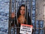 PETA behind the scenes with a caged Celina Jaitley