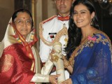 Pratibha Devisingh Patil presenting the Padma Shri Award at Rashtrapati Bhavan, in New Delhi
