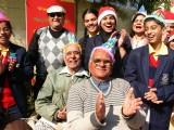 School children celebrating christmas with senior citizens at a old age home in a programme orginizied by help age India in New Delhi