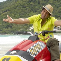 Govinda sitting on a motor bike | Partner Photo Gallery