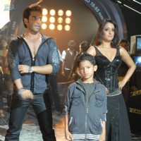 Tusshar and Raima standing with a kid