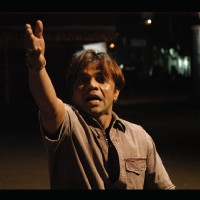 Rajpal Yadav trying to stop someone