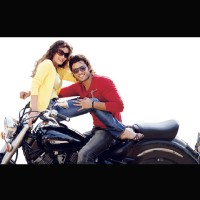 Kumar Saahil and Sneha Ullal sitting on a bike