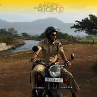 Shreyas Talpade sitting on a bike