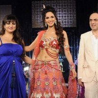 Mallika Sherawat walks the ramp for Anjalee and Arjun Kapoor at Aamby Valley City India Bridal Week