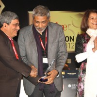"Vice-Chancellor M Aslam receiving the ""Best teaching practices Award"" from  Prakash Jha in New Delhi"