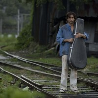 Shahid Kapoor standing on a railway track | Kaminey Photo Gallery