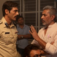Arjun Rampal and Prakash Jha on the set of Chakravyuh.