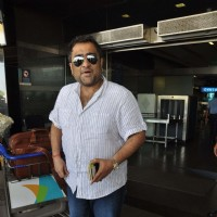 Singer Kunal Ganjawala snapped at Mumbai International Airport leaving for Dubai.