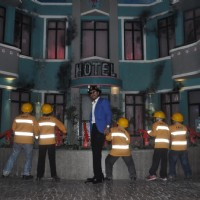 Shahrukh Khan with a group of children to rescue a hotel on fire at Kidzania's launch