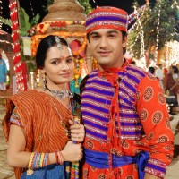 Mohan and Bhakti wearing a Gujrati outfit