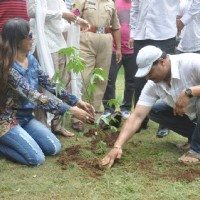 Tanisha Singh and Dayanand Sheety plant a tree