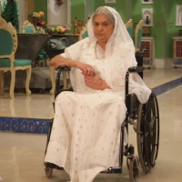 Devki Nanawati sitting on a wheel chair