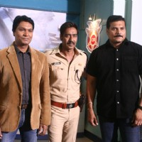 Aditya Srivastava, Ajay Devgn and Dayanand Shetty pose for the camera on C.I.D