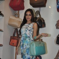 Shazahn Padamsee poses with a hand bag at the Launch of Madame's Studio Collection