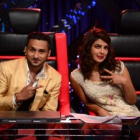 Yo Yo Honey Singh poses with Priyanka Chopra for the camera