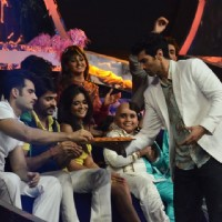 Aditya Roy Kapur distributes sweets to the contestants on Jhalak Dikhhlaa Jaa